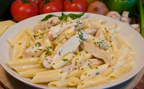A plate of chicken parmesan pasta